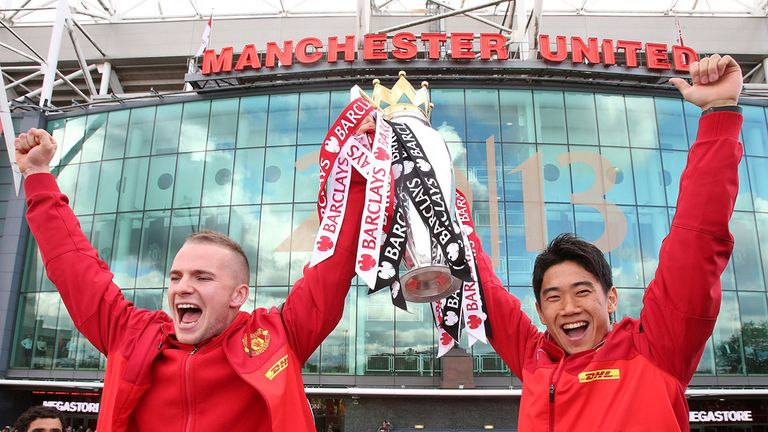 Tom Cleverley (left) celebrates United's 20th Premier League title with Shinji Kagawa
