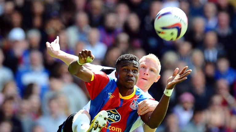 Wilfried Zaha: Holds off Peterborough's Craig Alcock