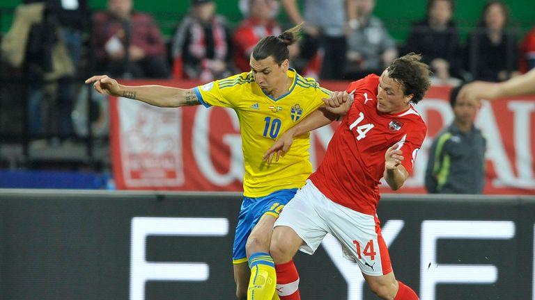 Austria's Julian Baumgartlinger vies with Zlatan Ibrahimovic