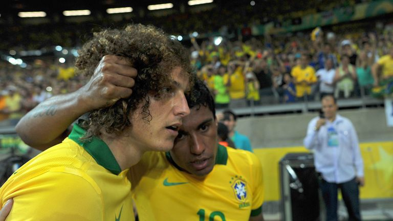 David Luiz and Paulinho: Chelsea defender has backed Brazil midfielder to shine in the Premier League