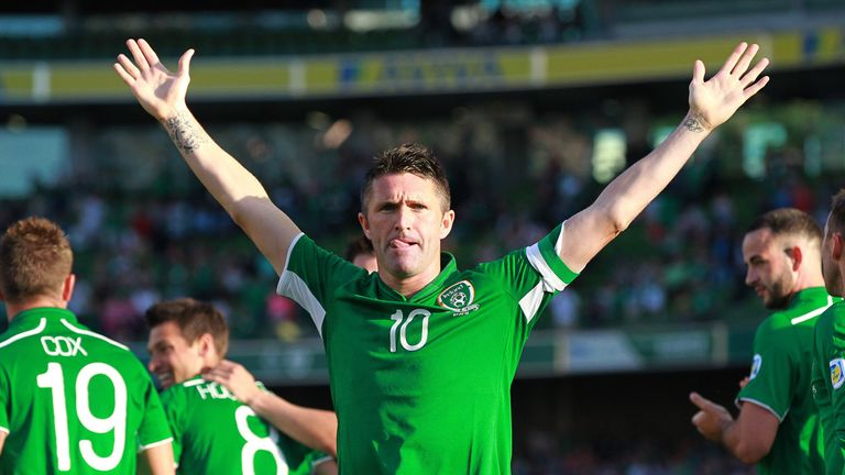 Robbie Keane celebrates a hat trick as he becomes Republic's most capped player