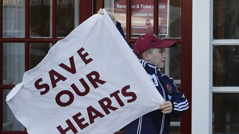 Hearts: A fan of the troubled club waves a flag outside Tynecastle
