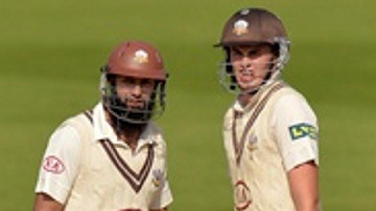 Dominic Sibley (right) with world No 1 Hashim Amla