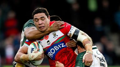 Tyson Frizell of Wales is tackled by Dominque Peyroux and Brad Takairangi at The Gnoll