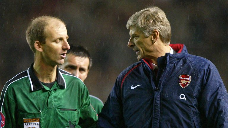 Arsenal manager Arsene Wenger has a word with match referee Riley