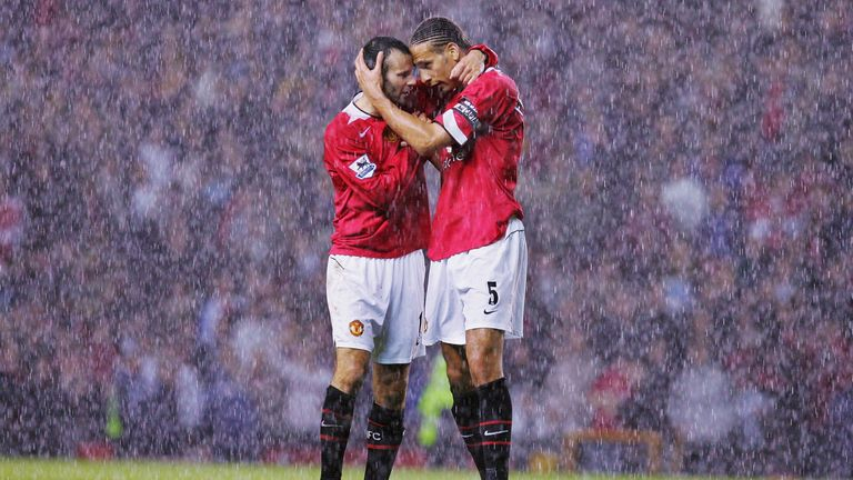 Ryan Giggs and Rio Ferdinand celebrate in the rain after the final whistle