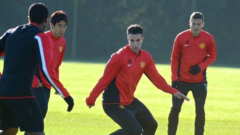 Robin van Persie and Nemanja Vidic have not travelled to Germany with Manchester United