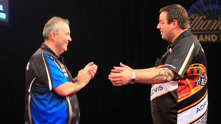 Phil Taylor and Adrian Lewis applaud each other after their epic contest