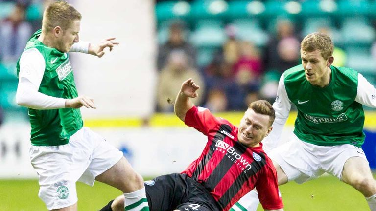 St Johnstone's Patrick Cregg (centre) goes over the top on Paul Cairney of Hibernian