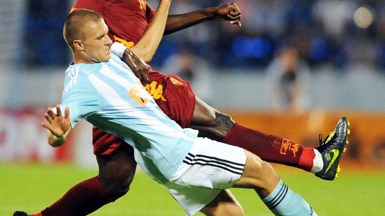Erik Cikos: Defender has joined Ross County on loan from Slovan Bratislava