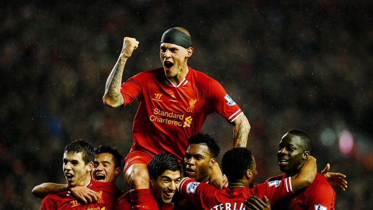 Liverpool celebrate during their 4-0 victory over Everton in 2014