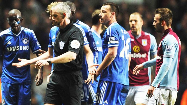 Referee Chris Foy had a busy evening officiating Aston Villa and Chelsea