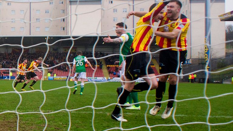 Partick players celebrate their second goal at Firhill Stadium