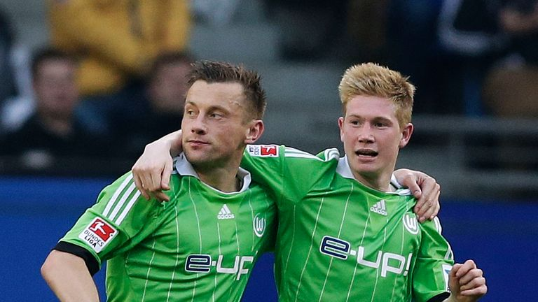 Ivica Olic (left) of Wolfsburg celebrates after scoring their first goal