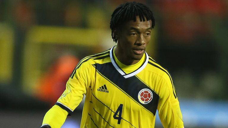 Juan Cuadrado of Colombia runs with the ball during the international friendly match between Belgium and Colombia
