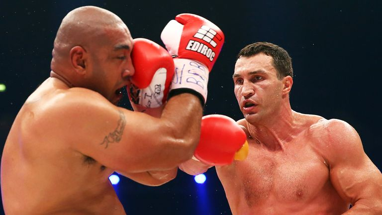 Klitschko (right)  lands on Alex Leapai on his way to another stoppage