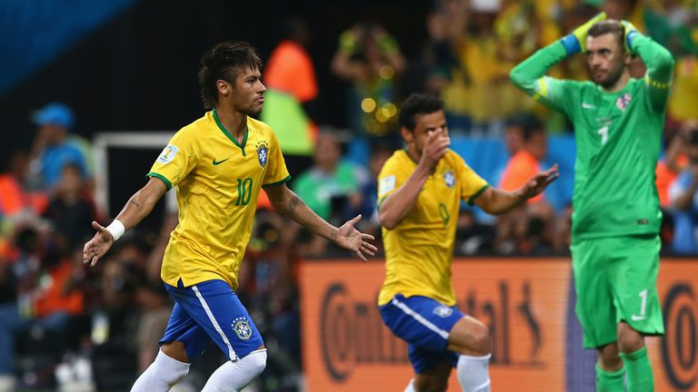 Neymar celebrates after scoring from the spot