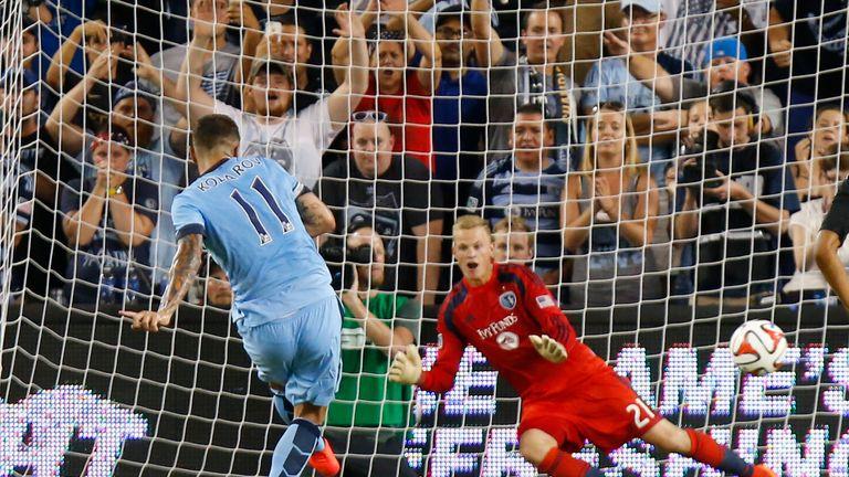 Aleksandar Kolarov of Manchester City scores a penalty in the win over Kansas