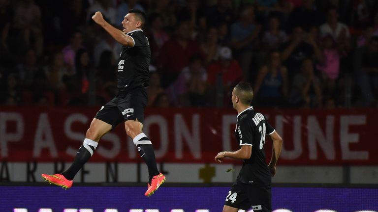 Caen's forward Mathieu Duhamel jumps for joy