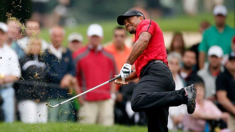 Tiger Woods hits his second shot on the second hole at Firestone
