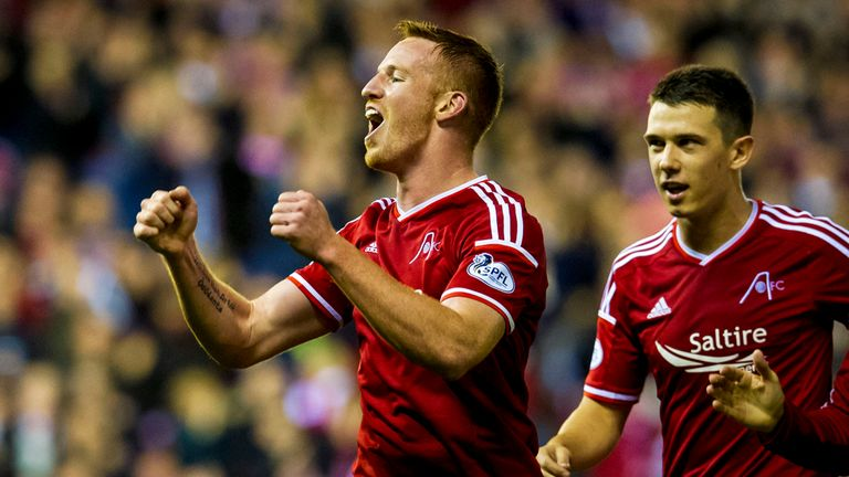 Adam Rooney celebrates after scoring against Livingston