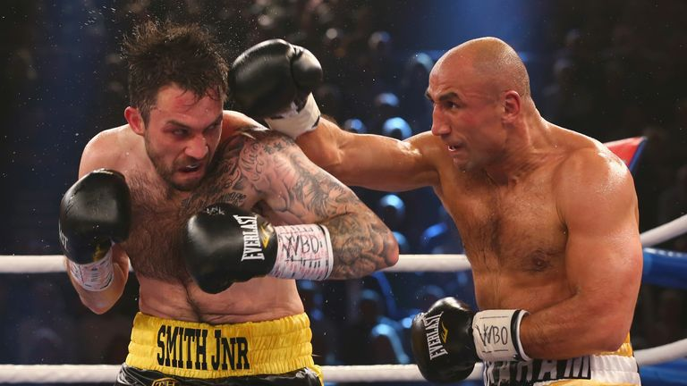 Arthur Abraham lands a punch on Paul Smith in the defence of his WBO super-middleweight title
