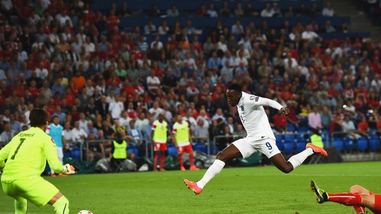 Bargain-buy: Danny Welbeck fires home England's opening goal of the night in Switzerland