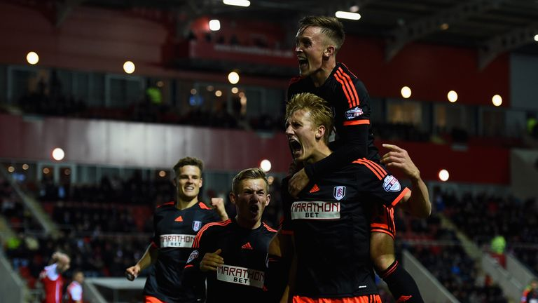 Dan Burn is mobbed by his team-mates after scoring Fulham's injury-time equaliser