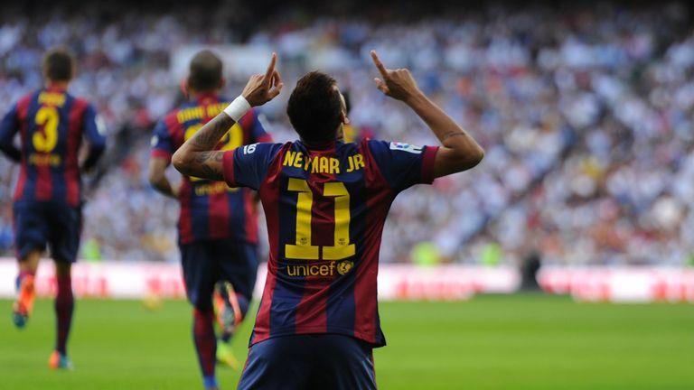 Neymar celebrates his earlier opener against Real in October 2014