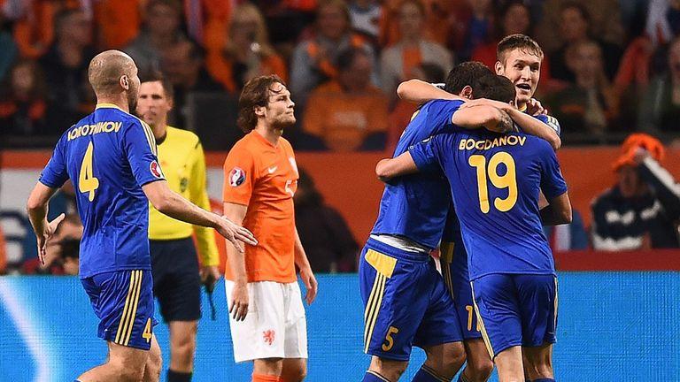 Kazakhstan: Celebrating after Renat Abdulin scored