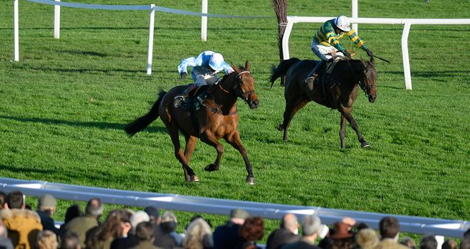 Champagne West holds off the challenge of Colour Squadron to score under Richard Johnson.