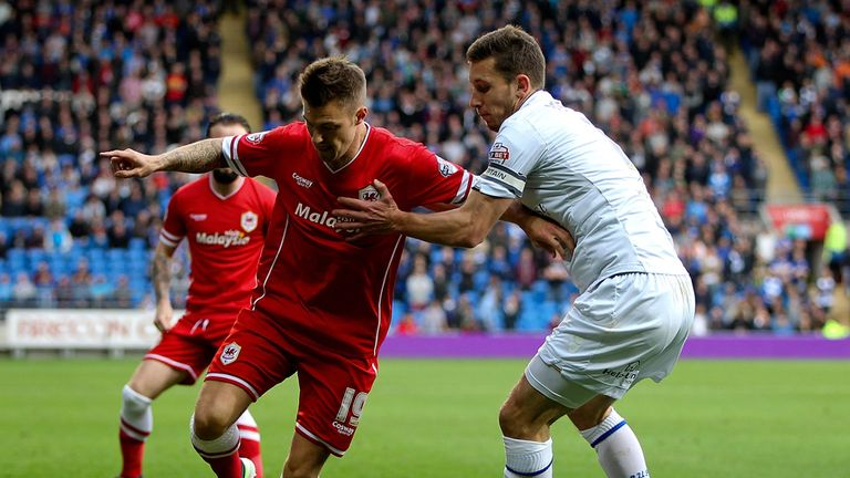 Cardiff's Anthony Pilkington holds off the challenge of Jason Pearce