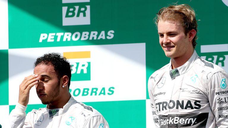 Nico Rosberg celebrates next to Lewis Hamilton