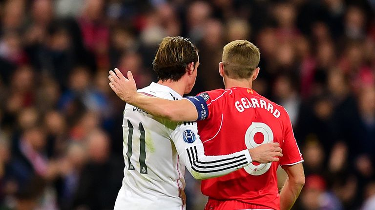Real's Gareth Bale (left) and Liverpool's Steven Gerrard embrace in 2014