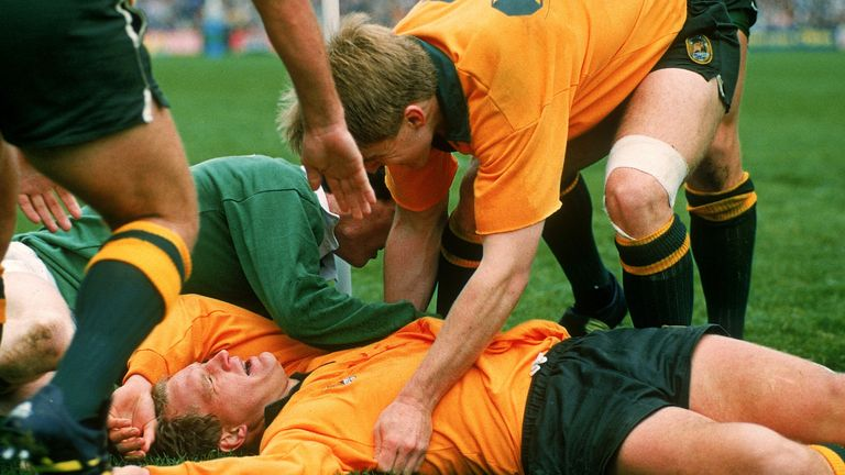 Michael Lynagh is too tired to celebrate after scoring the try that sent the Wallabies into the 1991 semi-final at the expense of Ireland