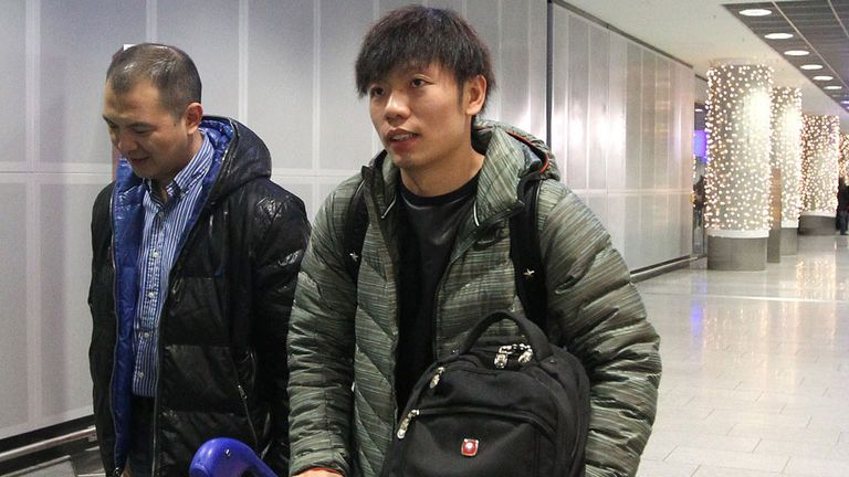Zhang Xizhe arrives at Frankfurt airport in Germany on Saturday.