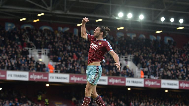 Andy Carroll celebrates scoring his second as West Ham beat Swansea