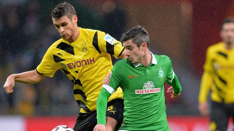 Sebastian Kehl of Dortmund is challenged by Fin Bartels
