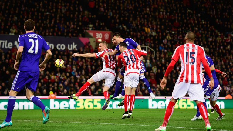 John Terry gets above Geoff Cameron and Ryan Shawcross to head in Chelsea's opener at Stoke