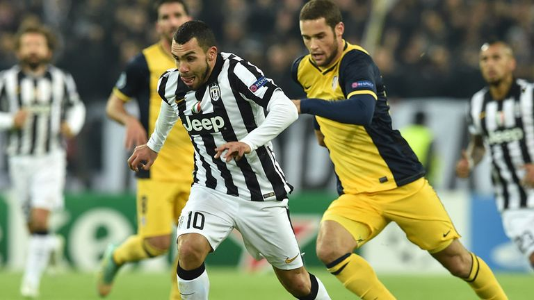Carlos Tevez: In action in the goalless draw with Atletico Madrid.