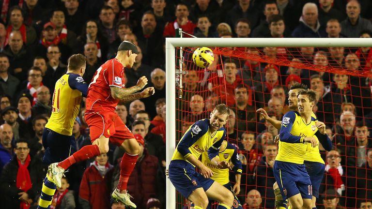 Martin Skrtel heads home Liverpool's equaliser against Arsenal