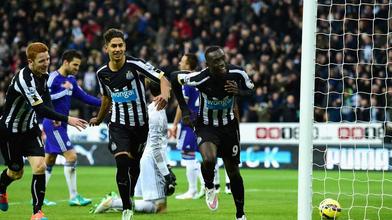 Papiss Cisse celebrates the first of his two goals against Chelsea at St James' Park last season