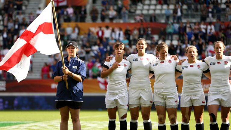 Hunter and Clark stand for the anthems before their victorious 2014 World Cup final