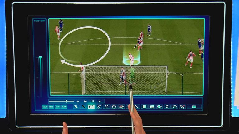 Peter Crouch is drawn to Cesc Fabregas' corner, and moves into the circle to leave space behind him