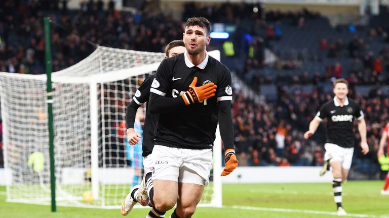 Nadir Ciftci: Celebrates after scoring the winner at Hampden Park