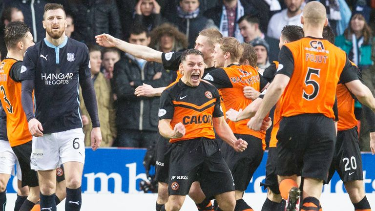 Dundee United players celebrate their third goal in the derby