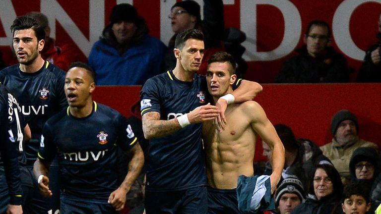Dusan Tadic (R) was the match-winner at Old Trafford