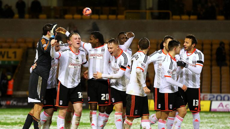 Fulham players celebrate victory.