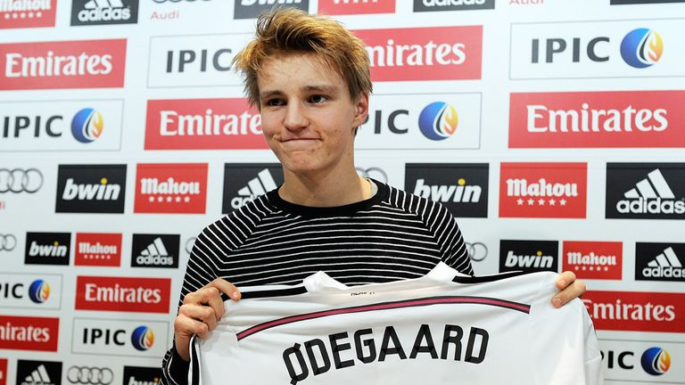 Martin Odegaard with his Real Madrid shirt.