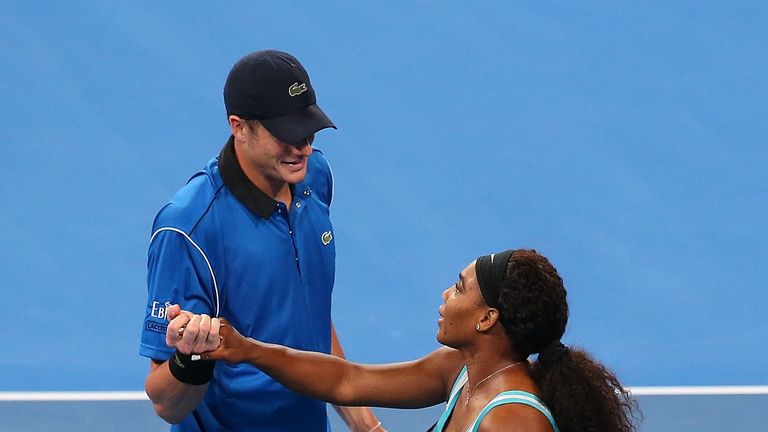 John Isner and Serena Williams celebrate after winning the mixed doubles